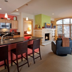 The full kitchen and living room in a 1 bedroom/1 bathroom condo at the Edelweiss Lodge & Spa. - ©Edelweiss Lodge & Spa