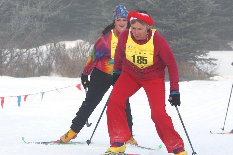 Female skiers racing in Alaska.