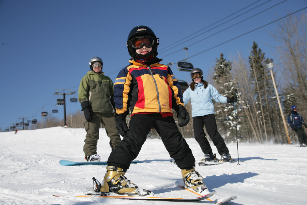 A family enjoys a day of skiing and snowboarding, Spirit Mountain, Minnesota