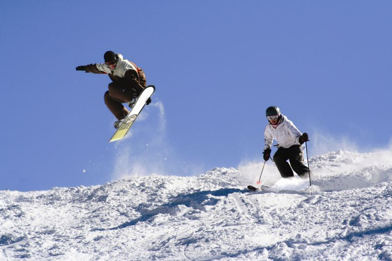 A snowboarder and a skier at Verbier