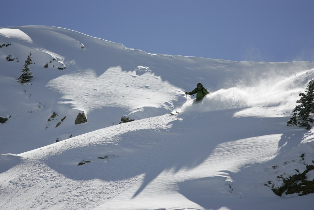 This skier gets powder in the backcountry of Keystone, Colorado