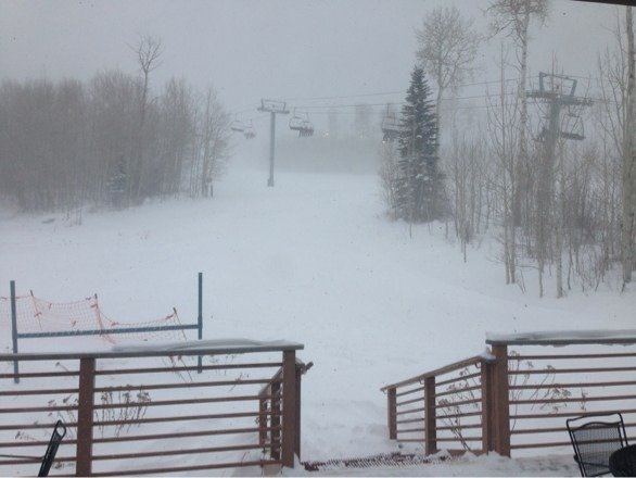 It's blowing snow sideways. Great opening day. The weather must've scared off a lot of people. No lines and lots of runs open.