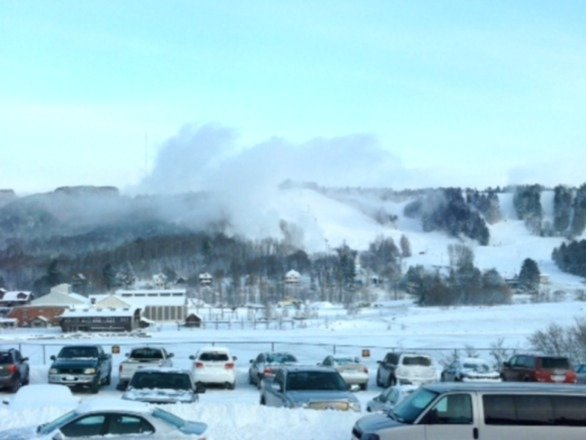 "Mont Ripley making clouds. First time we've seen the sun in 2 weeks. 93"" of snow so far this winter."