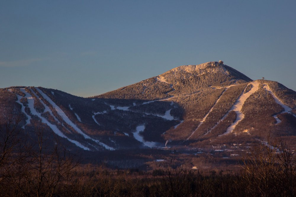 Sunrise casts an alpen glow on Jay Peak's iconic summit. - ©Jay Peak Resort