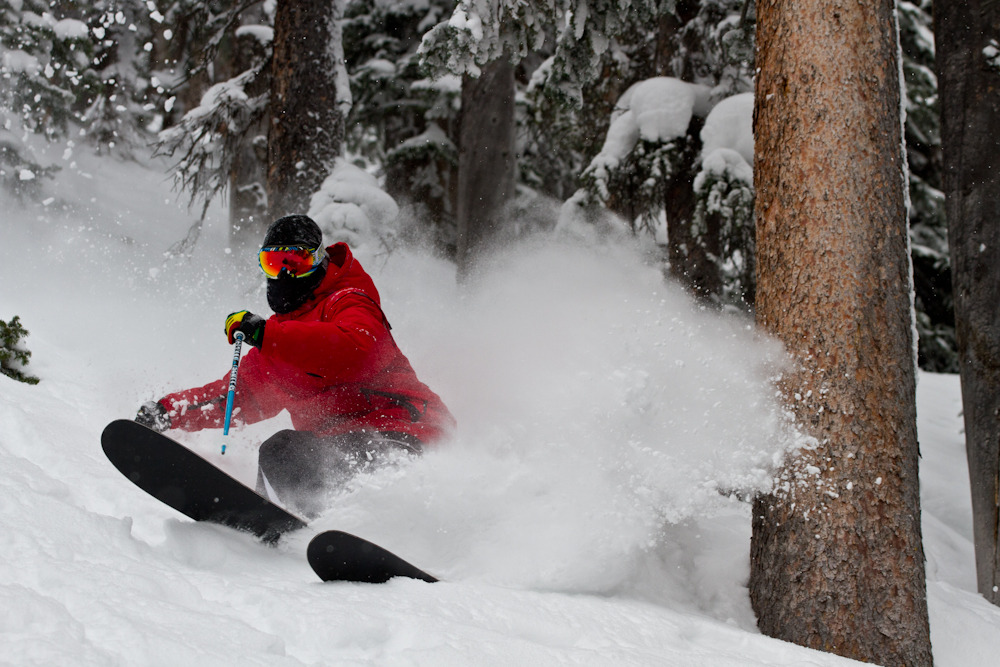 "Skier Kevin ""Bert"" Flores kicks up fresh powder on one of Monarchs great tree lines. Photo by Liam Doran"