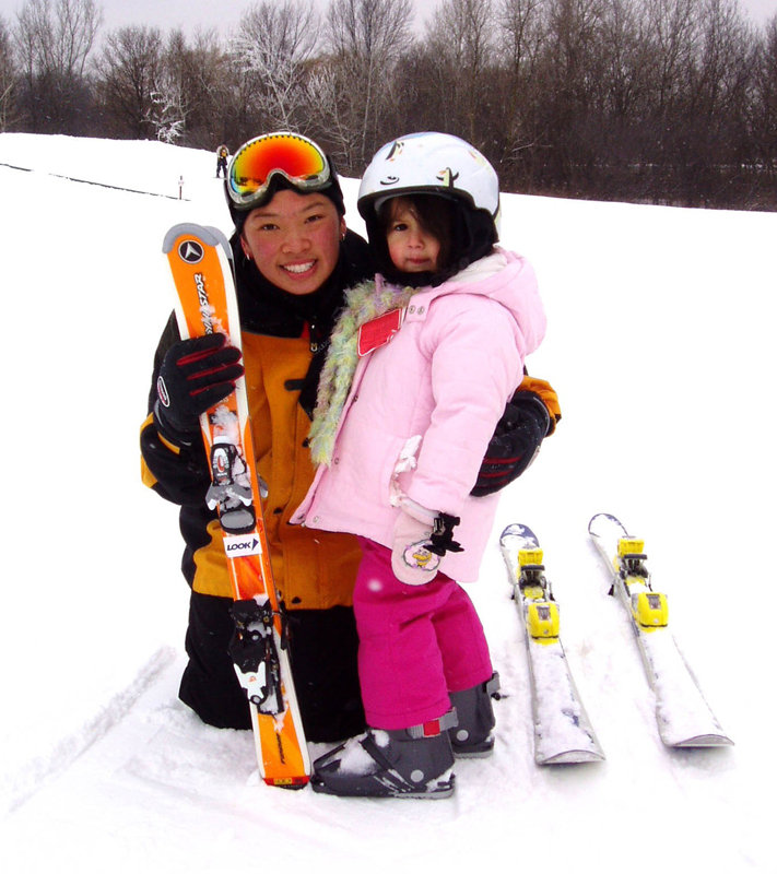 An instructor and a little girl at Seven Oaks, Iowa.