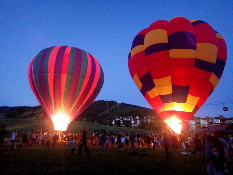 Steamboat hosts the Balloon Rodeo at dusk, at the base area. - © Photo courtesy Shannon Luthy Lukens.