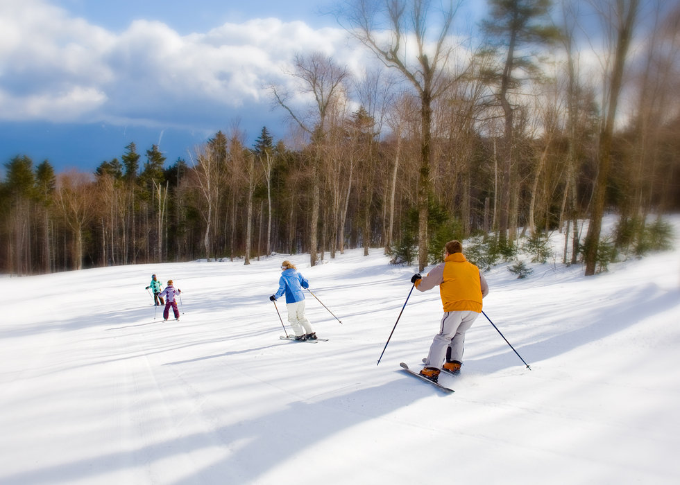 A family skiing in Bretton Woods, New Hampshire