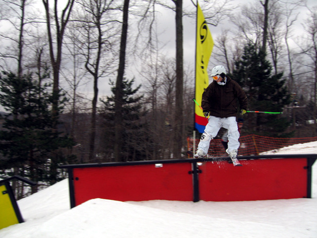 A skier rides a rail in the terrain park at Snow Trails, Ohio