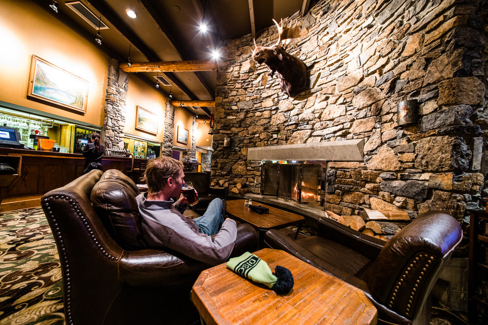 Fireplace, moose head, leather seats, beer. Not much more you could ask for after a long day skiing Sunshine Village pow. - © Liam Doran