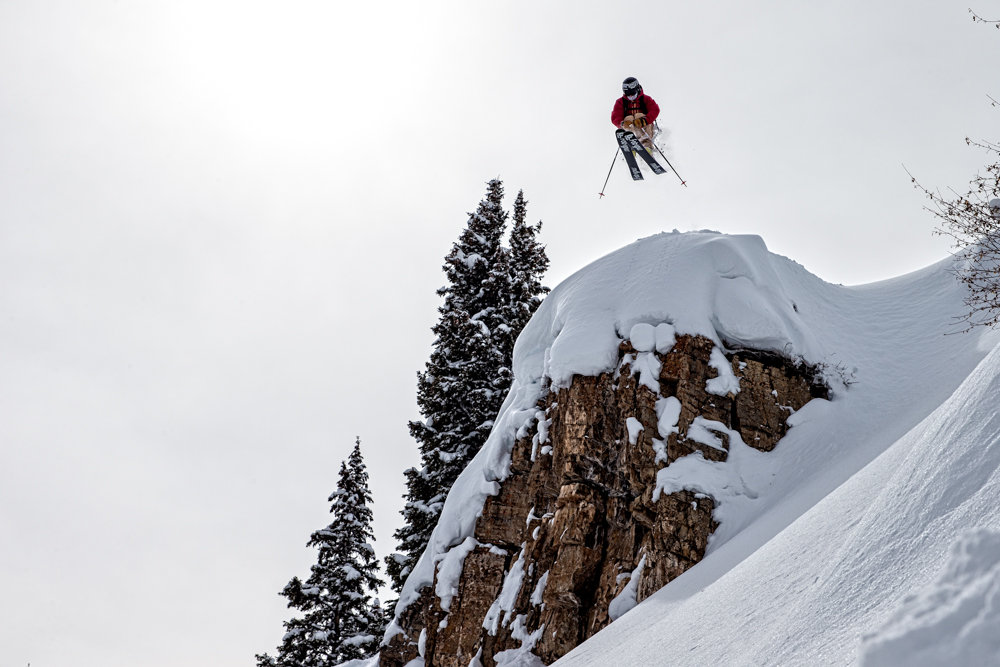 Flying high on the way to more untouched powder. - © Liam Doran