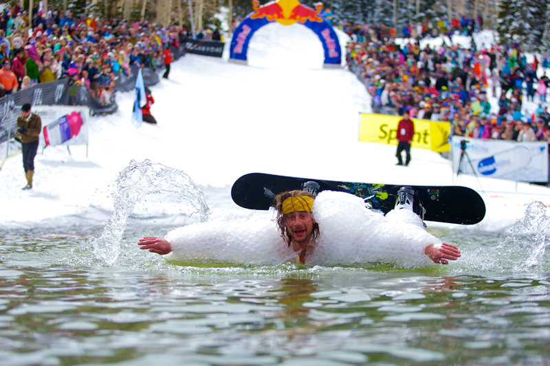 Costumes and fun are mandatory during Canyons Resort's annual pond skimming party. - © Courtesy of Canyons Resort