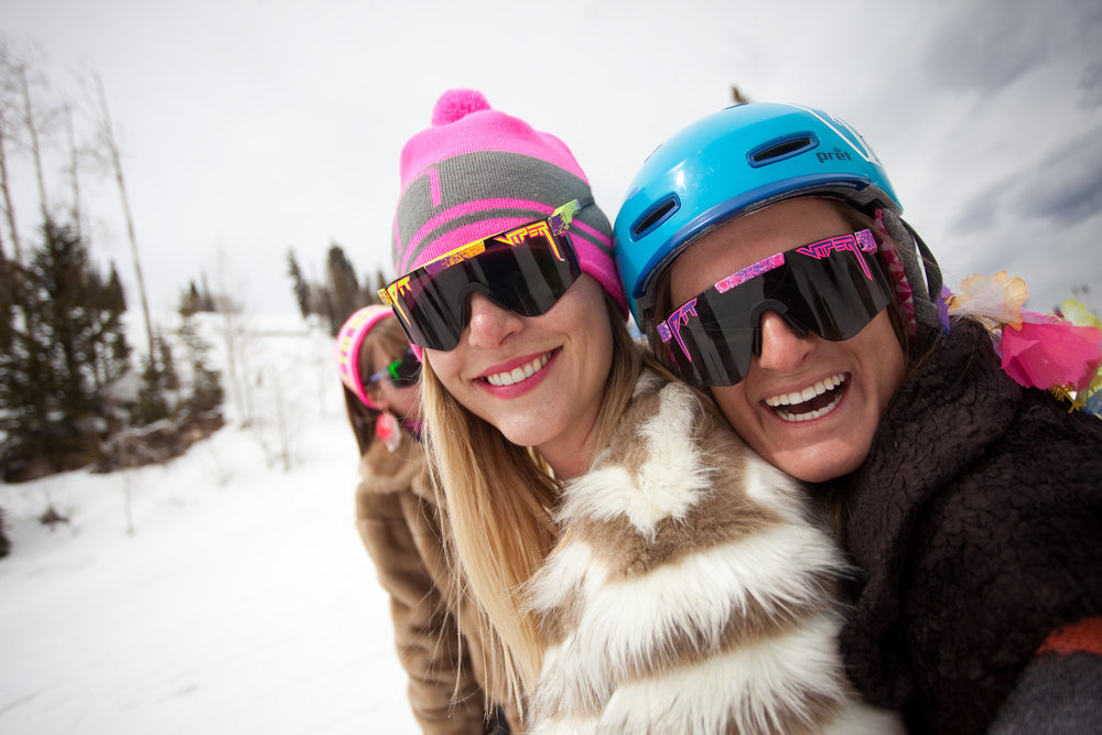 Meredith and Meaghan Lynch, a friend and co-worker in the PR department, rock Pit Vipers during a 'Get the Girls Out' ski day on Aspen Mountain. The event is organized by She Jumps as part of a national campaign to unite women in the outdoor sports world. - © Jeremy Swanson