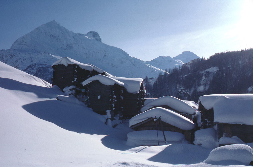Snowcapped roofs in the town of Saas Fee.