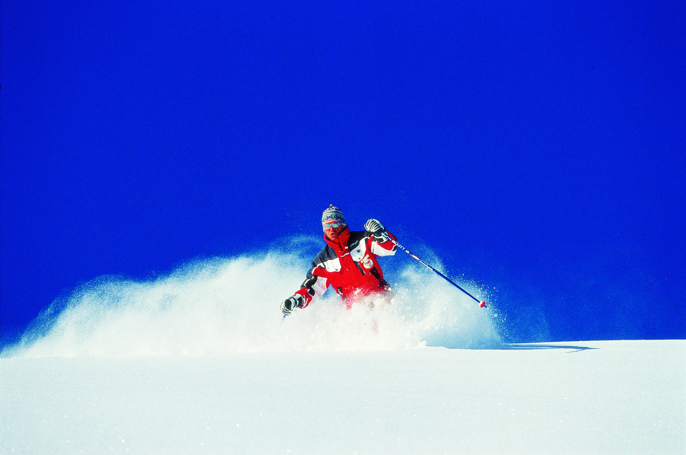 Skier in heavy powder at Hochfugen, AUT.