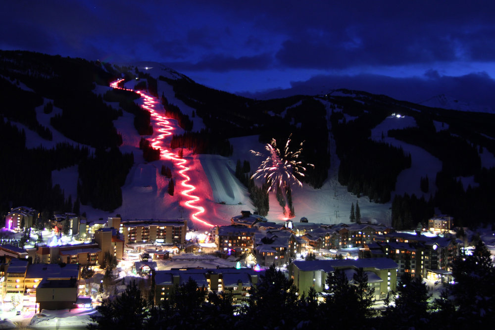 Torchlight and fireworks light up the night at Copper Mountain. - © Copper Mountain