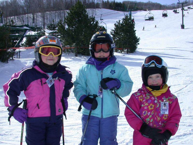 A group of young skiers pose for a photo in Blue Mountain, Ontario