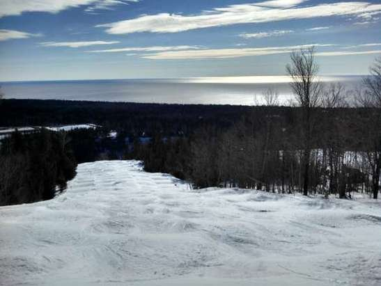 Lutsen Mountains - Moguls, steeps, and nice views. Lutsen has it all. With no new snow and warm temps, they're doing a great job of nightly grooming. Gets mushy in the pm so start early. The moguls are fun when they soften up, but flatter areas get real slow. Thank goodness they have a decent base. You can sit home and pray for more snow or get it while it lasts. - © rmm
