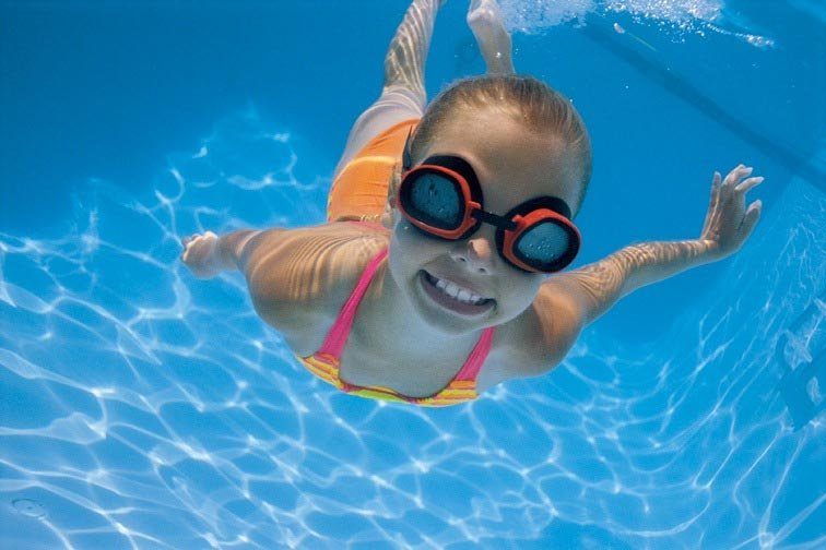 A young visitor swimming in the Bear Valley Lodge pool.