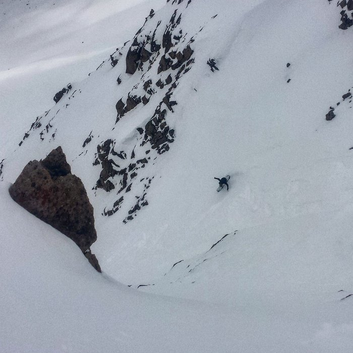 Zach Andrada gets after A-Basin's East Wall on 5/22/15. - © Greg Morgano