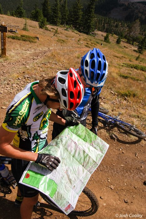 Riders reviewing the Monarch Crest trail map. - © Josh Cooley