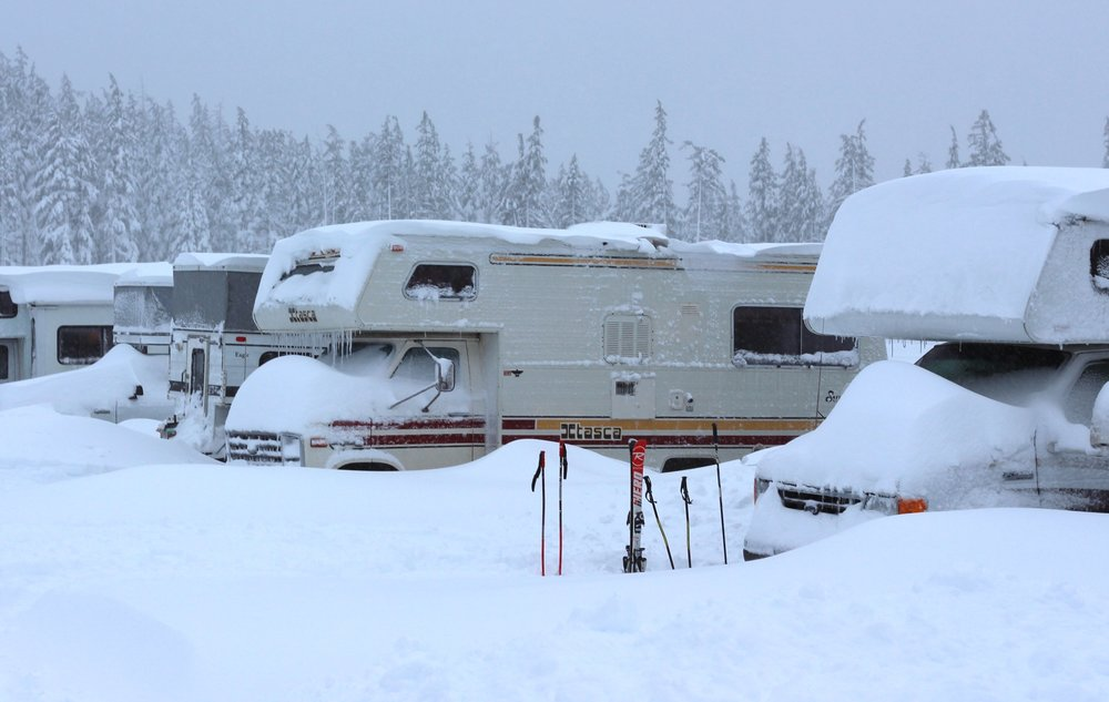 Snow piled up around RVs of skiers in the parking lot at Mt. Bachelor. - © Mt. Bachelor Resort