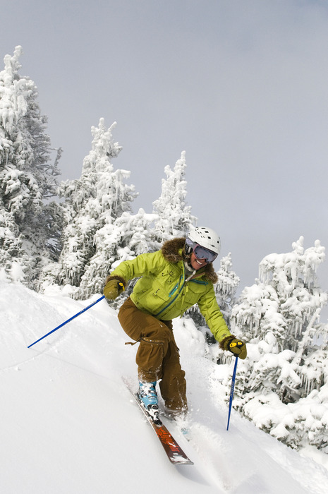 Skier in trees at Smugglers' Notch