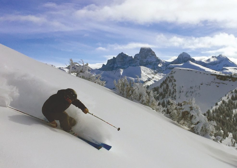 Skiing powder at Grand Targhee with a view of Grand Teton. - © Court Levy