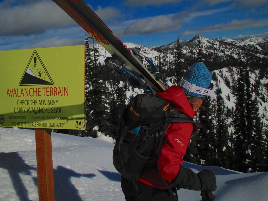 A skier readies to go into the backcountry from Whitefish Mountain Resort. - © Becky Lomax