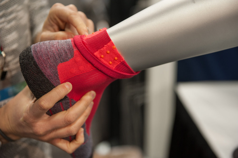 Falke makes high-end, sport and gender-specific base layers, including this light compression running sock with beads that gently massage the achilles. - © Ashleigh Miller Photography