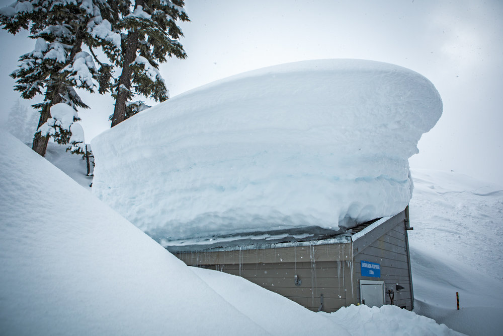 Snow piles up on the weather station at Whistler Blackcomb. - © Coast Mountain Photography