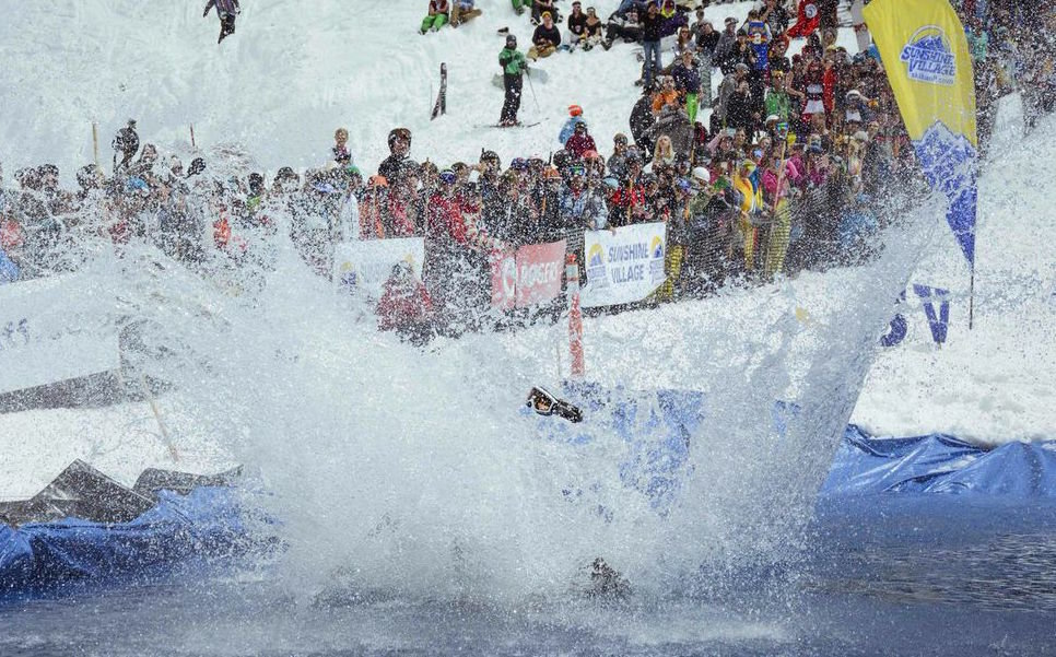 Pond skimming is all about big splashes for crowd appeal.  - © Sunshine Village