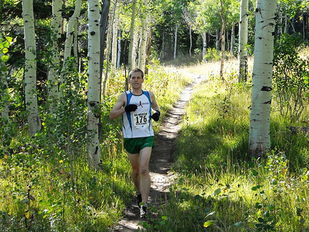 A runner passes through aspen stands along the Mid Mountain Trail in Park City, Utah. - © Mountain Trails Foundation
