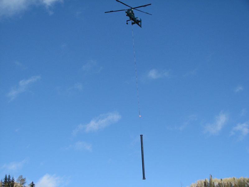 Helicopter in ski lift construction work