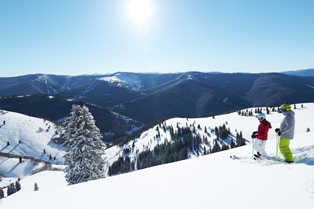 Taking a moment before dropping into Vail's back bowls. - © Vail