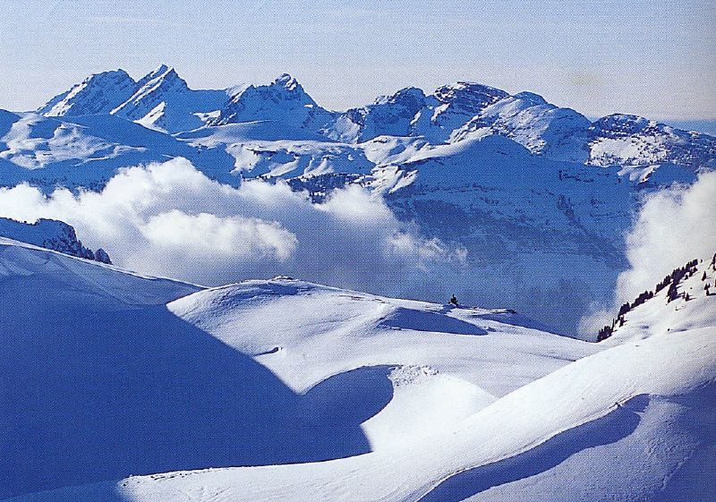 Clouds and snowy mountains dominate the scenery of Flaine, FRA.