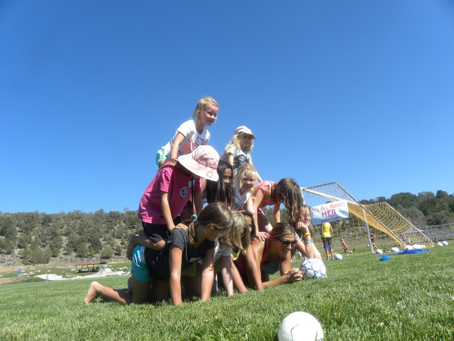 The girls built a pyramid and a love for sports over two days with U.S. Ski Team athletes. Photo by Aaron Garland.