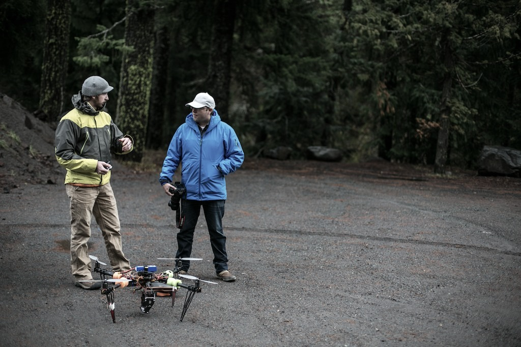 Mike Hagadorn and Tim Shisler discuss how to best get a heli shot - © Liam Doran