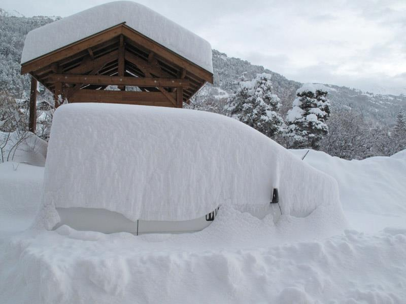 Snow-covered car in Serre Che. Dec. 14, 2012