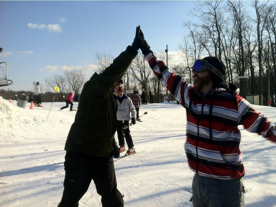 Bring a first-time friend along and you can both score during Learn to Ski and Snowboard Month. High five! Photo Courtesy of Bear Creek Resort.