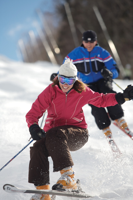 Two skiers make some fresh tracks at Mount Sunapee.