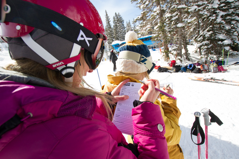 Ski tester Susan Minneci fills out a tester card in between testing skis. - © Liam Doran