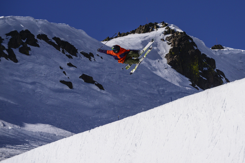 Skier boosting out of the new 22-foot super pipe on Mainline at Squaw. - © Matt Palmer & Squaw Valley