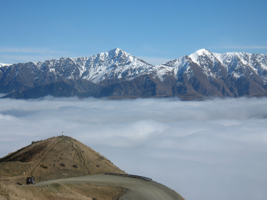 The road between The Remarkables Resort and Queenstown somewhere below the clouds - © Jussarian