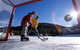 A father and his sons enjoy playing hockey in Keystone, Colorado at Lakeside Village