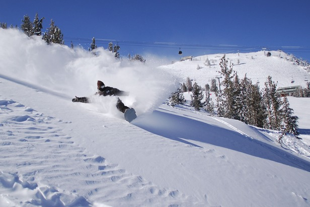 This rider finds powder in the backcountry of Mammoth Mountain, California