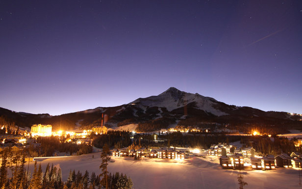 Big Sky's Mountain Village lights up at night.  - © Chris Kamman/Big Sky Resort