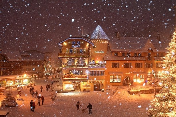Top family ski resort: Snowy Megeve village at night  - © bionnassay images
