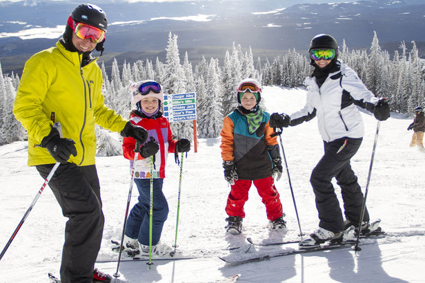 A family enjoying skiing at Big White.