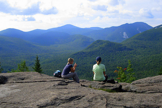 Snack time on Mt. Jo overlooking the Great Range of the Adirondack High Peaks.  - © Courtesy of the Adirondack Mountain Club